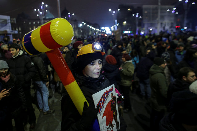 People take part in a demonstration to protest against government plans to reform some criminal laws through emergency decree, in Bucharest, Romania, January 29, 2017. (Photo by Octav Ganea/Reuters/Inquam Photos)