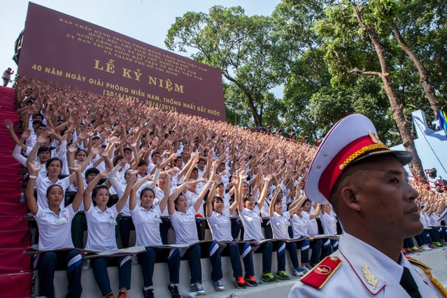 Vietnamese students cheer during celebrations marking the 40th anniversary of the end of the Vietnam War in Ho Chi Minh City, Vietnam, 30 April 2015. (Photo by Le Quang Nhat/EPA)