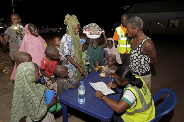 Women and children rescued from Boko Haram in Sambisa forest by Nigeria Military register at the Internally displaced people's camp in Yola, Adamawa State, Nigeria May 2, 2015. (Photo by Afolabi Sotunde/Reuters)