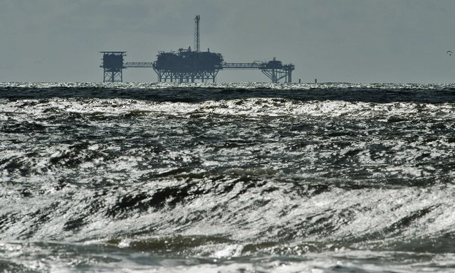 An oil and gas drilling platform stands offshore in the Gulf of Mexico off Dauphin Island, Alabama, U.S. on October 5, 2013. (Photo by Steve Nesius/Reuters)