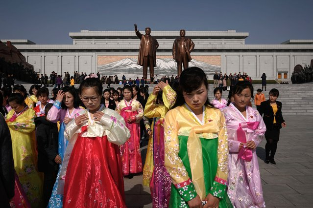 "A group of women wearing traditional dress leave after paying their respects before the statues of late North Korean leaders Kim Il Sung and Kim Jong Il, as part of celebrations marking the anniversary of the birth of Kim Il Sung, known as the ""Day of the Sun"", on Mansu hill in Pyongyang on April 15, 2019. (Photo by Ed Jones/AFP Photo)"