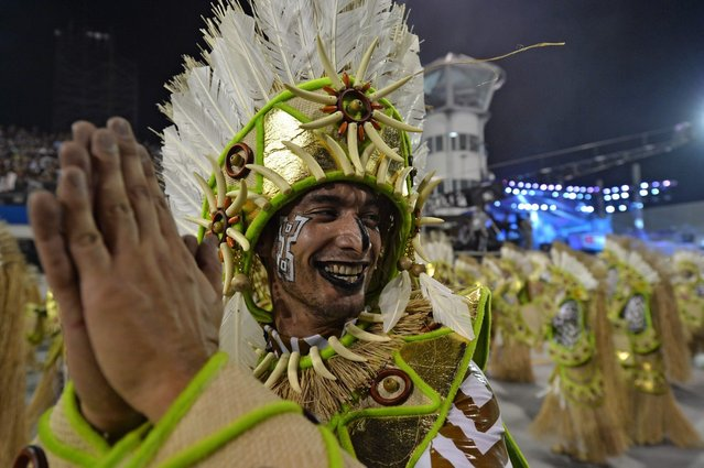A reveler of the Mocidade Alegre samba school performs during the second night of carnival parade at the Sambadrome in Sao Paulo, Brazil on March 1, 2014. (Photo by Nelson Almeida/AFP Photo)