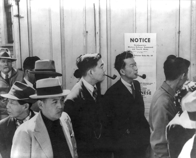 Residents of Japanese ancestry line up for registration in San Francisco, April 1942. (Photo by Dorothea Lange/Library of Congress/Reuters)