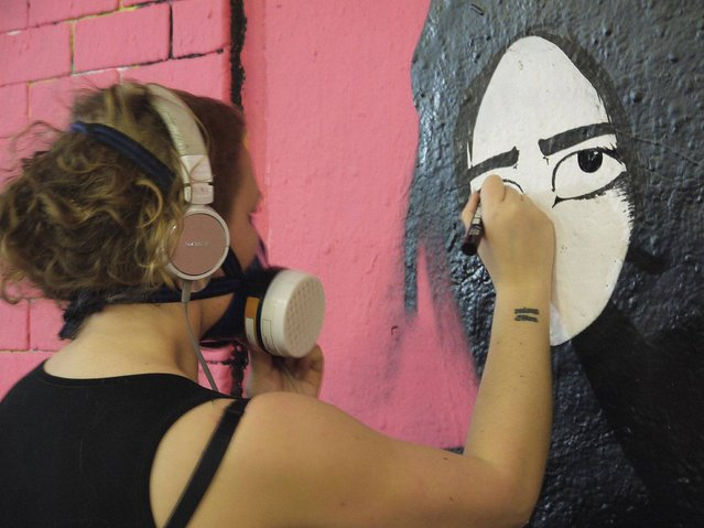 Girl with a Curl in the process of painting her mural. (Photo by Dez Mighty/Susan Mackey)