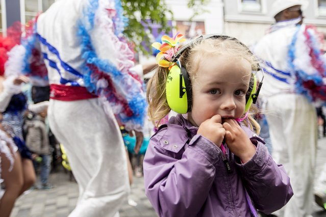 A child looks on during the Copenhagen Carnival parade May 23, 2015. (Photo by Jens Astrup/Reuters/Scanpix Denmark)