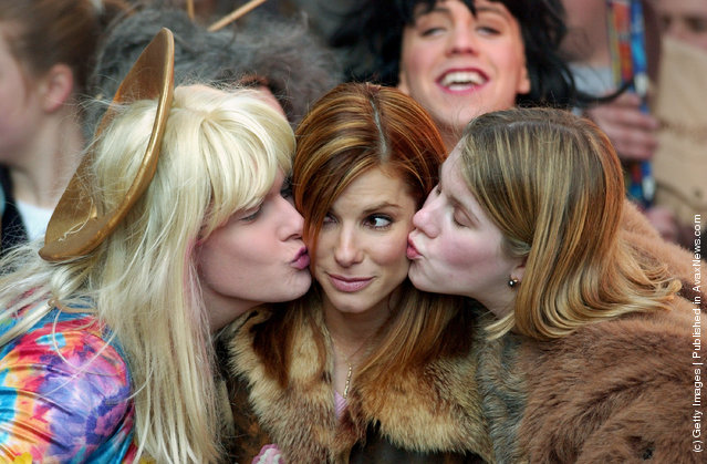 Hasty Pudding Theatricals Woman of the Year Sandra Bullock gets kisses from Vice President John Blickstead and President of Hasty Pudding Theatricals Clare Putnam