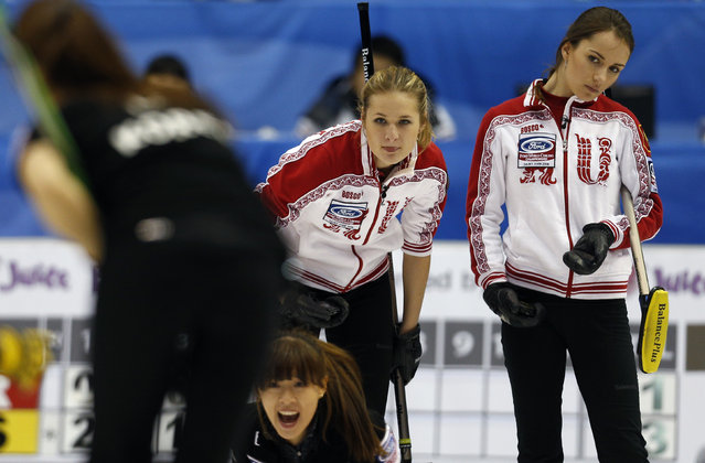 Russia's third Margarita Fomina and skip Anna Sidorova (R) look at their opponent's shot during their page playoff game against South Korea at the World Women's Curling Championships in Saint John, New Brunswick, March 22, 2014. (Photo by Mathieu Belanger/Reuters)