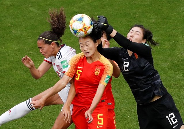 China's Haiyan Wu and goalkeeper Shimeng Peng in action with Spain's Andrea Falcon during the France 2019 Women's World Cup Group B football match between China and Spain, on June 17, 2019, at the Oceane Stadium in Le Havre, northwestern France. (Photo by Bernadett Szabo/Reuters)
