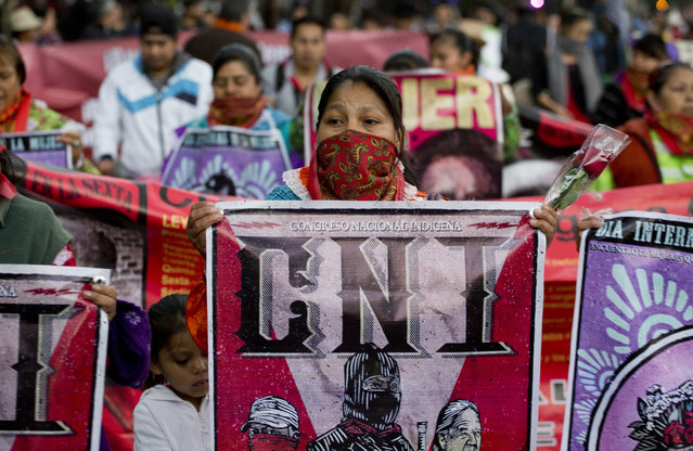 Women from the National Indigenous Congress march during a demonstration marking International Women's Day in Mexico City, Wednesday, March 8, 2017. Many women demonstrated by staying home from work, joining rallies or wearing red Wednesday as International Women's Day was observed with a multitude of events around the world. (Photo by Eduardo Verdugo/AP Photo)