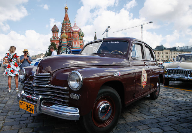 A vintage car before the 2019 GUM Motor Rally featuring classic cars in Moscow, Russia on July 28, 2019. The route of the rally changes each year but always takes in Moscow's best-known landmarks. (Photo by Artyom Geodakyan/TASS via Getty Images)