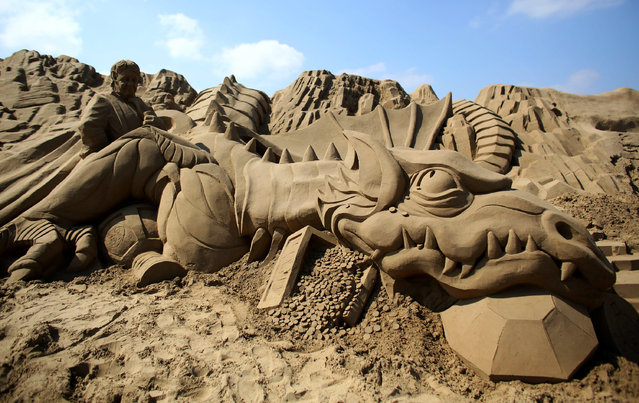 "Detail of a sand sculpture is seen as pieces are prepared as part of this year's ""Once Upon a Time"" themed annual Weston-super-Mare Sand Sculpture festival on April 16, 2014 in Weston-Super-Mare, England. (Photo by Matt Cardy/Getty Images)"