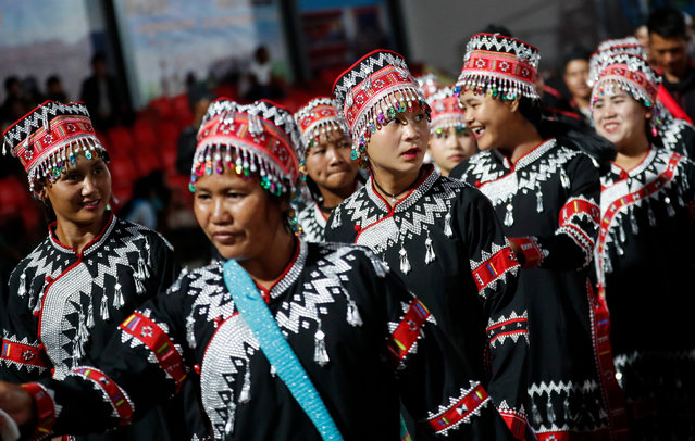 Wa ethnic women in traditional dresses attend a rehearsal session for the 30th anniversary of Wa State celebration in Panghsang, also called Pang Kham, of autonomous Wa region, north-eastern Myanmar, 15 April 2019. Panghsang, the administrative capital of Wa independent region has begun preparing the 30th anniversary of Wa State founding which will be held on 17 April. Wa has declared its independence on 17 April 1989. Although the government of Myanmar does not recognize the sovereignty of Wa State, Myanmar military cease fired with them on 09 May 1989. Wa State has been notorious for drug smuggling in the Golden Triangle of the last 30 years, although it declared its region a drug-free zone in 2005. (Photo by Lynn Bo Bo/EPA/EFE)