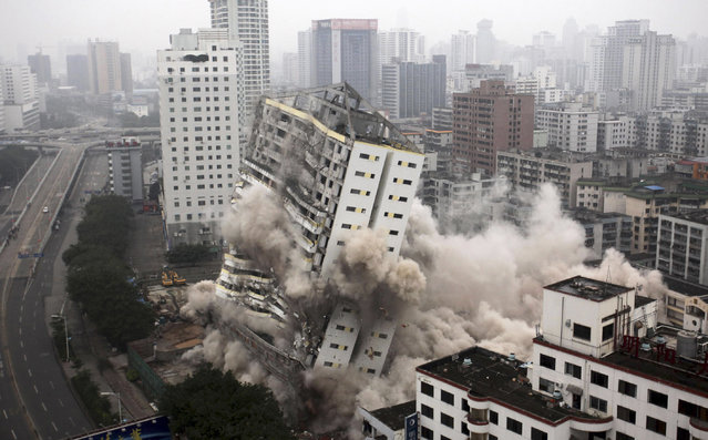 The former Hainan Airlines headquarters topples during a controlled demolition in Haikou, Hainan province, China, December 25, 2012. (Photo by Reuters/China Daily)