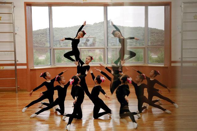 Girls practice dancing at the Mangyongdae Children's Palace in central Pyongyang, North Korea May 5, 2016. (Photo by Damir Sagolj/Reuters)