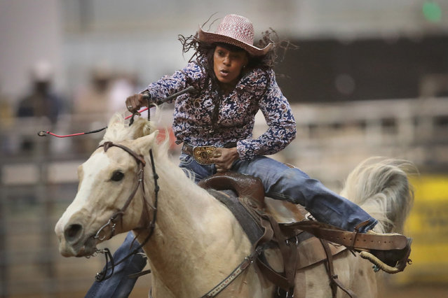 A cowgirl participates in the barrel race competition at the Bill Pickett Invitational Rodeo on April 1, 2017 in Memphis, Tennessee. (Photo by Scott Olson/Getty Images)