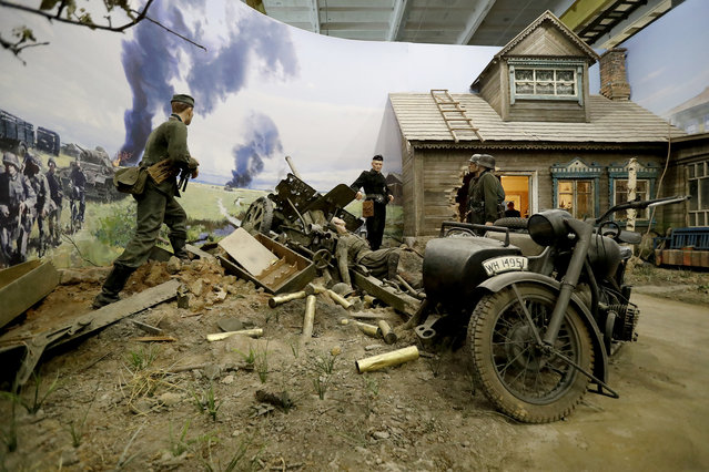 """A scene showing the beginning of the war with the German invasion in Belarus 1941 is prepared for the opening of the 3D Panorama exhibition """"Memory talks. The road through war"""" in the former Sevcabel port in St. Petersburg, Russia, 16 September 2019. (Photo by Anatoly Maltsev/EPA/EFE)"""