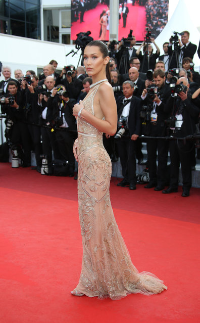 Model Bella Hadid poses for photographers upon arrival for the screening of the film Cafe Society and the Opening Ceremony at the 69th international film festival, Cannes, southern France, Wednesday, May 11, 2016. (Photo by Joel Ryan/AP Photo)