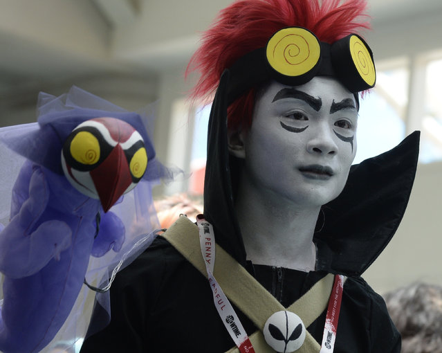 A costumed attendee on the third day of Comic Con International in San Diego, California, July 11, 2015. (Photo by Robyn Beck/AFP Photo)
