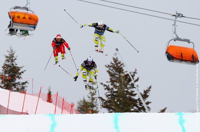 Chris Del Bosco (C) of Canada soars toward the finish line to win the men's Sprint U.S. Grand Prix Ski Cross Finals ahead of Brady Leman (R) of Canada in second place and Amin Niederer (L) of Switzerland in the third place at The Canyons Ski Resort