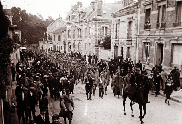 An archive picture shows captured Germans soldiers marching through Chalons en Champagne, Eastern France September 1915. (Photo by Collection Odette Carrez/Reuters)
