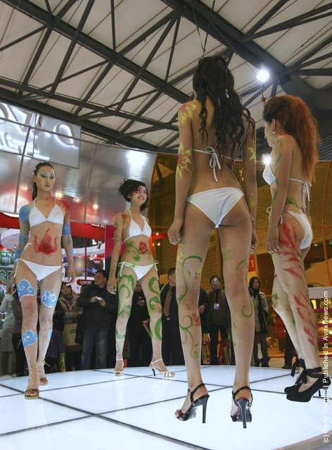 Models with body paint model lingerie during a fashion show of the 87th China Cotton Knitwear Trade Fair, at the Shanghai New International Expo Centre