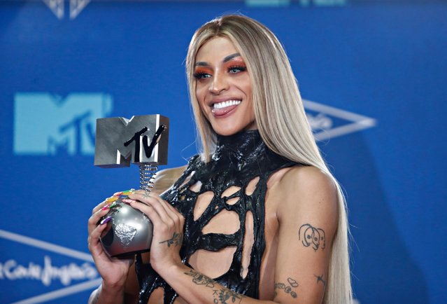 Pabllo Vittar poses with the Best Brazilian Act award at the backstage during the 2019 MTV Europe Music Awards at the FIBES Conference and Exhibition Centre in Seville, Spain, November 3, 2019. (Photo by Jon Nazca/Reuters)