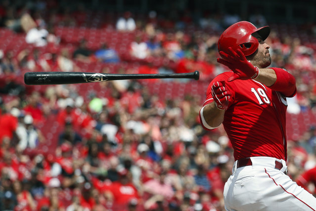 Cincinnati Reds' Joey Votto loses his bat on a swing in the sixth inning of a baseball game against the Colorado Rockies, Sunday, May 21, 2017, in Cincinnati. (Photo by John Minchillo/AP Photo)