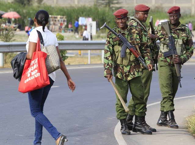 Members of the General Service Unit (GSU) policemen patrol a section of an over-pass where U.S. President Barack Obama will be driving through during his arrival for his three-day state visit, in Kenya's capital Nairobi July 24, 2015. Obama departed for Kenya on Thursday, his first trip to his father's homeland as U.S. president, kicking off a swing through Africa that will also include a stop in Ethiopia. (Photo by Noor Khamis/Reuters)