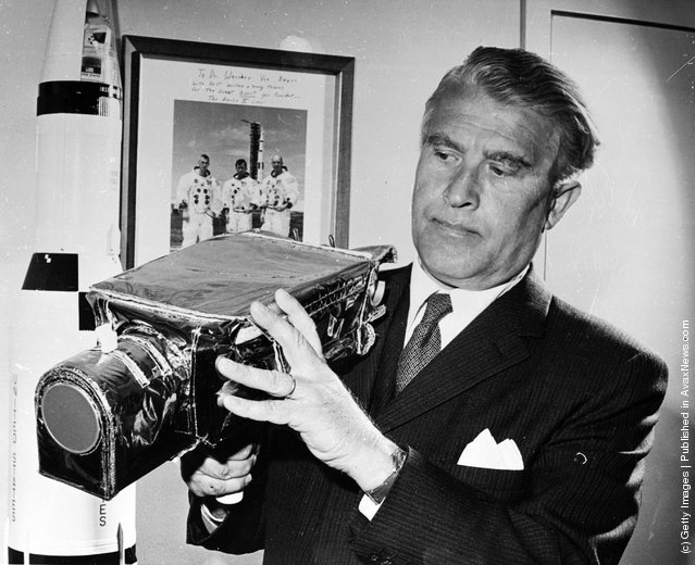 1971: German-born American rocket pioneer and NASA administrator Dr Wernher von Braun (1912 - 1977) examines the camera which is to be used for the Apollo 15 Lunar Landing Mission