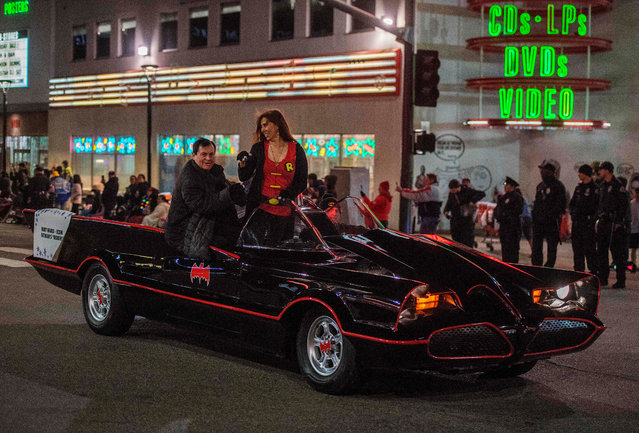 """US actor Burt Ward (L), known for playing Robin in the """"Batman"""" television series, rides down Sunset Blvd during the 88th annual Hollywood Christmas Parade in Hollywood, California on December 1, 2019. (Photo by Mark Ralston/AFP Photo)"""