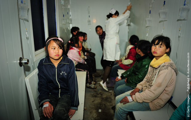 Students receive treatments at a local hospital in Zhijin County, Guizhou Province of China