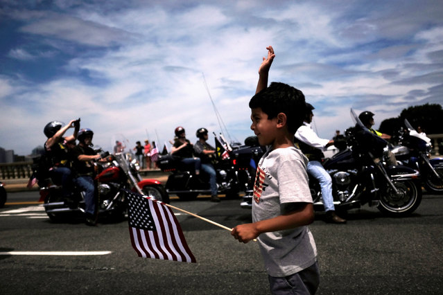 Motorcyclists participate in Rolling Thunder, the annual ride around Washington Mall to raise awareness for prisoners of war and soldiers still missing in action, in Washington, U.S., May 29, 2016. (Photo by James Lawler Duggan/Reuters)