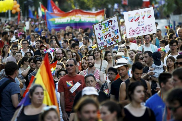Participants of an annual gay pride parade march before an Orthodox Jewish assailant stabbed and injured six participants in Jerusalem on Thursday, police and witnesses said July 30, 2015. (Photo by Amir Cohen/Reuters)