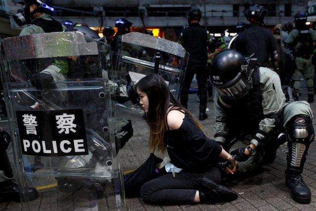 Riot police detain a protester during an anti-government rally in central Hong Kong, China on October 6, 2019. (Photo by Jorge Silva/Reuters)