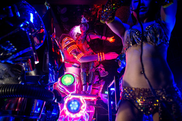 Dancers perform on large scale female robots during a show at The Robot Restaurant on June 29, 2014 in Tokyo, Japan. The now famous Robot Restaurant opened two years ago in Kabukicho area of Shinjuku at an estimated cost of 10 million U.S. dollars. (Photo by Chris McGrath/Getty Images)