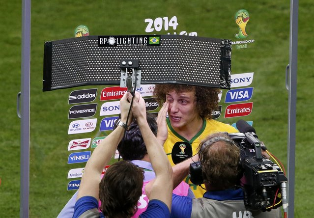 Brazil's David Luiz reacts after they lost their 2014 World Cup semi-finals against Germany at the Mineirao stadium in Belo Horizonte July 8, 2014. (Photo by David Gray/Reuters)