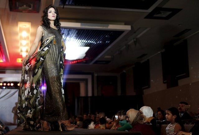 A model presents a creation by Iraqi designer Waffa Al-Shathar during a fashion show at the Hunting Club in Baghdad August 13, 2015. (Photo by Thaier al-Sudani/Reuters)