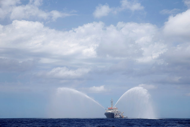 The Migrant Offshore Aid Station (MOAS) ship Topaz Responder tests its fire hoses during a crew training exercise as the ship stands by for migrants in distress in international waters off the coast of Libya, June 22, 2016. (Photo by Darrin Zammit Lupi/Reuters)