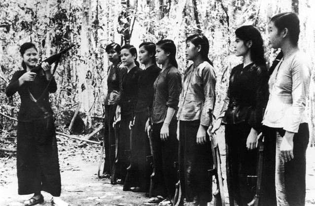 A small group of North Vietnamese women undergoing rifle training before joining Viet Cong forces during the Vietnam War, 11th September 1967. Their weapons are of American origin