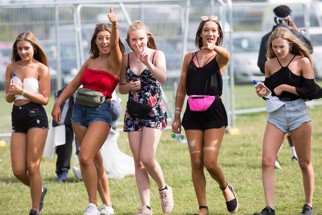 Festival goers arrive at V Festival, Weston Park, Staffordshire, England on August 19, 2017. (Photo by Geoff Robinson)