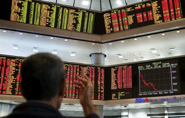 An investor monitors share market prices at a brokerage firm in Kuala Lumpur, Malaysia, August 24, 2015. Asian stocks slumped to 3-year lows on Monday as a slide in Chinese equities gathered pace, hastening an exodus from riskier assets as fears of a China-led global economic slowdown churned through markets. (Photo by Olivia Harris/Reuters)