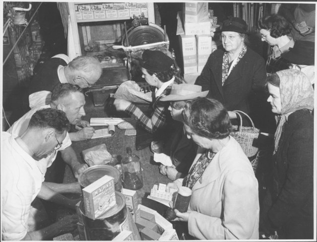 Women shopping with coupons during world War II in Drouin, Victoria, ca. 1944