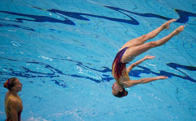Switzerland's team performs their free routine in the synchronised swimming event at the 32nd LEN European swimming championships on August 14, 2014 at the Europa-Sportpark in Berlin. (Photo by John Macdougall/AFP Photo)