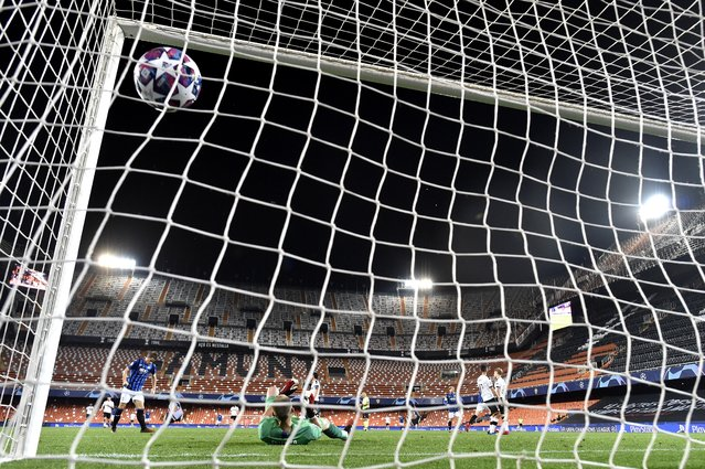 Atalanta's Josip Ilicic scores his side's third goal during the Champions League round of 16 second leg soccer match between Valencia and Atalanta in Valencia, Spain, Tuesday March 10, 2020. The match is being in an empty stadium because of the coronavirus outbreak. (Photo by UEFA via AP Photo)
