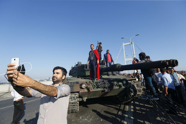 A man takes a selfie in front of a tank after troops involved in the coup surrendered on the Bosphorus Bridge in Istanbul, Turkey July 16, 2016. (Photo by Murad Sezer/Reuters)