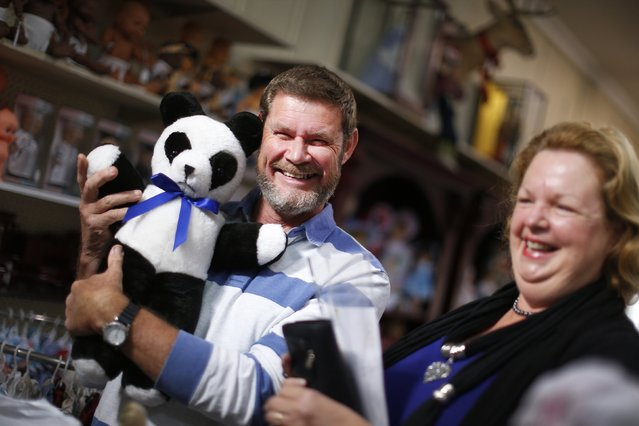 Customers Sue and Allan Paviour are pictured with their teddy bear that had been repaired as they collect it at Sydney's Doll Hospital, May 20, 2014. (Photo by Jason Reed/Reuters)