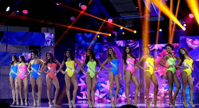 Contestants compete in the bathing suit portion of the Miss Venezuela 2012 beauty contest in Caracas on August 30, 2012. (Photo by Ariana Cubillos/Associated Press)