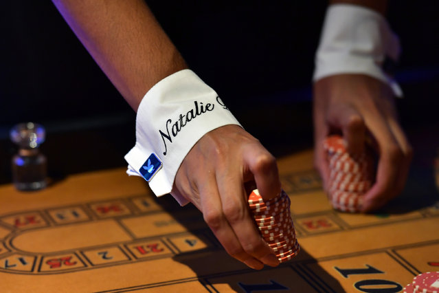 A Playboy Bunny's name is displayed on the cuff of her costume as she practices her croupier skills before starting work at the Playboy Club on July 26, 2016 in London, England. (Photo by Carl Court/Getty Images)