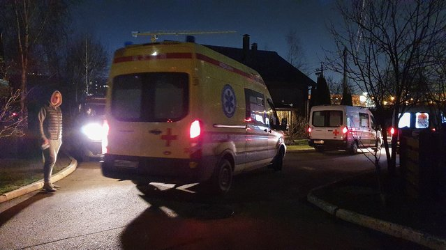 Ambulances are parked at a retirement home after a fire, in Moscow, Russia, Thursday, April 9, 2020. A fire in a retirement home in Moscow killed at least four people and injured more then ten others, but firefighters managed to rescue 50 people from the burning building, emergency officials said Thursday. (Photo by Kirill Voronin, Moscow News Agency Photo via AP Photo)