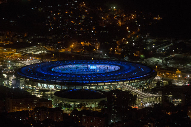 The Maracana Stadium is seen lit up ahead of the 2016 Summer Olympic Games on July 31, 2016 in Rio de Janeiro, Brazil. (Photo by Chris McGrath/Getty Images)